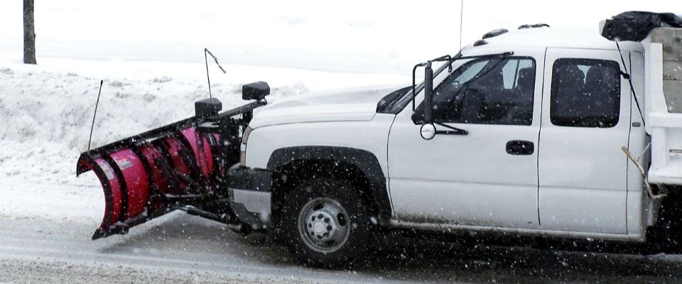 white truck with snow plow